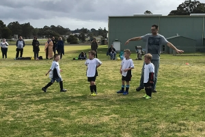 Collie Junior Soccer Club with coach